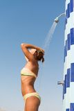 Sensuous slim woman taking shower at the beach Royalty Free Stock Image