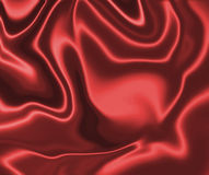 Sensuous Smooth Red Satin #2. Brilliant red, shiny, and smooth silky satin complete with luxurious folds and shadows for depth Royalty Free Stock Photo