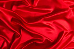 Sensuous Smooth Red Satin. Sensuous Smooth Red Shining Satin and pattern thereof Stock Images