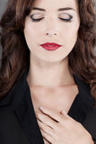 Sensuous woman beautiful red lips eyes closed. Closeup portrait of sensuous brown haired woman with beautiful red lips and eyes closed Royalty Free Stock Photo