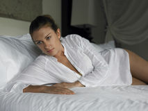 Sensuous Woman Lying In Bed. Sensuous young women lying in bed at home Stock Images