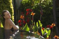 Sensuous Woman In Outdoor Swimming Pool. Sensuous young woman in outdoor swimming pool Stock Image