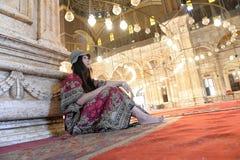 Sentada asiática de la mujer Imagenes de archivo