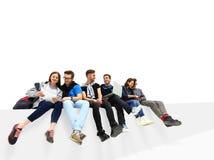 Sentada causal del grupo de personas Imagen de archivo libre de regalías