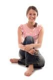Sentada de la mujer joven imagen de archivo libre de regalías