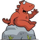 Sentada del dinosaurio Foto de archivo libre de regalías