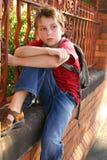 Sentada del estudiante de la escuela Fotografía de archivo