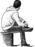 Sentada del hombre Imagen de archivo libre de regalías