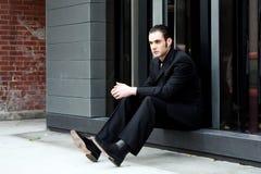 Sentada del hombre de negocios Foto de archivo