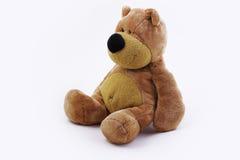 Sentada del oso del peluche Fotos de archivo libres de regalías