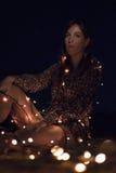 Sentada del seria de Chica Fotografía de archivo
