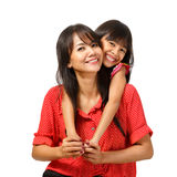 Sentada feliz de la madre y de la hija Imagen de archivo
