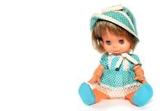Sentada feliz de la muñeca de la muchacha Foto de archivo