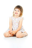 Sentada feliz de la niña fotos de archivo libres de regalías