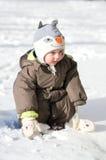Sentada feliz del muchacho Foto de archivo libre de regalías