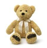 Sentada feliz del oso de peluche Fotos de archivo libres de regalías