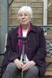 Sentada jubilada de la mujer Fotos de archivo