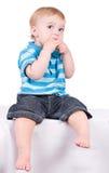 Sentada linda del niño Imágenes de archivo libres de regalías