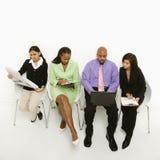 Sentada Multi-ethnic de la unidad de negocio. Imagen de archivo libre de regalías