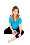 Sentada sonriente de la mujer embarazada Imagenes de archivo