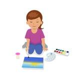 Sentada y pintura adolescentes de la muchacha un paisaje Fotografía de archivo