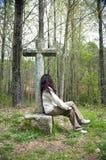 Sentarse la cruz Fotos de archivo