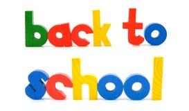 Sentença de volta à escola em letras coloridas de madeira Fotos de Stock Royalty Free