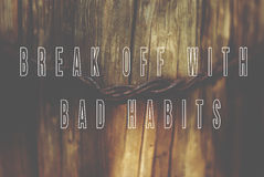 Sentence break off with bad habits written on natural wooden bac Stock Images