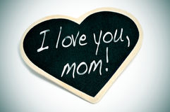 I love you, mom. Sentence I love you, mom written with chalk on a heart-shaped blackboard Royalty Free Stock Images