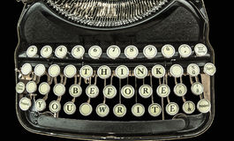 Sentence:  Think before you write. On the old, black typewriter Royalty Free Stock Photos