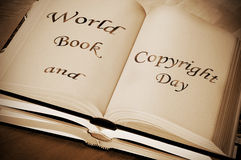 World book and copyright day. Sentence world book and copyright day, celebrated each year on april 23, written on an open book Royalty Free Stock Image