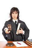 Sentencing. Angry female judge pointing at you in a courtroom. Eyes on focus and blurred gavel royalty free stock image