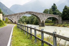 Sentiero della Valtellina (Lombardy, Italy). Sentiero della Valtellina, bicycle path along the Adda river iat summer. Historic stone bridge near Morbegno ( Stock Images