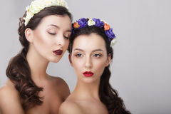 Sentiment. Glamor. Gorgeous Women In Wreaths Of Flowers Royalty Free Stock Photos