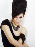 Sentiment. Pensive Bright Woman with Black Updo Hair and Necklace Stock Photography
