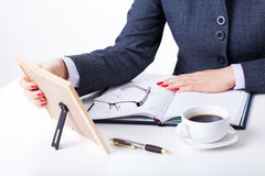 Sentimental businesswoman by her desk Royalty Free Stock Image