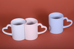 A sentimental couple and lover. This pair of cups represent a couple sentimental, through color and forms Royalty Free Stock Photos