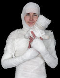 Sentimental man in bandage with mummy bear Stock Image