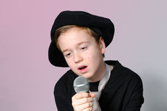 Sentimental song. Boy singing a sentimental song royalty free stock photo