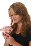 Sentimental woman with flowers Stock Photography