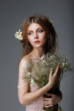 Sentimentality. Redhaired Affectionate Muse with Flowers in Dreams Royalty Free Stock Image