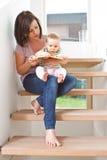 Sentimento bom em casa com meu bebê Fotos de Stock Royalty Free
