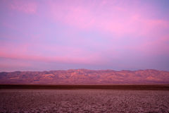 Sentinel Mountain Telescope Peak Badwater Road Death Valley Basin. Sunrise comes to the valley floor in Death Valley National Park Stock Photography