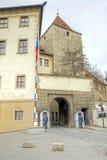 Sentinels on an entrance and Prague Castle. CZECH REPUBLIC, PRAGUE - April 28.2014: Security entrance in an ancient fortress Prague Castle Royalty Free Stock Photography