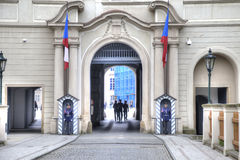 Sentinels on an entrance and Prague Castle Stock Image