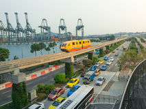 Sentosa Express run pass the harbour. Royalty Free Stock Photos