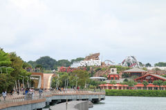 Sentosa island. SINGAPORE - JULY 9, 2017 : Tourists taking pictures in front of Universal Studios Sentosa island Stock Photo