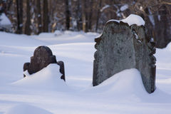 Sentries. Two headstones and the drifting snow Royalty Free Stock Photos