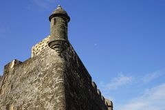 Sentry box of Castillo de San Cristobal with pale moon on the background, Puerto Rico Stock Images