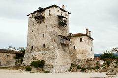 Sentry serf tower on coast, Ouranoupoli. Sentry serf tower on coast,  Ouranoupoli, Halkidiki, Greece Royalty Free Stock Photo